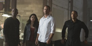 "Tyrese Gibson, Michelle Rodriguez, Paul Walker and Chris Bridges 'Ludacris' star in ""Furious 7."" Photo credit: Universal Pictures"