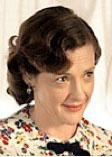 Joan as Miss Bond